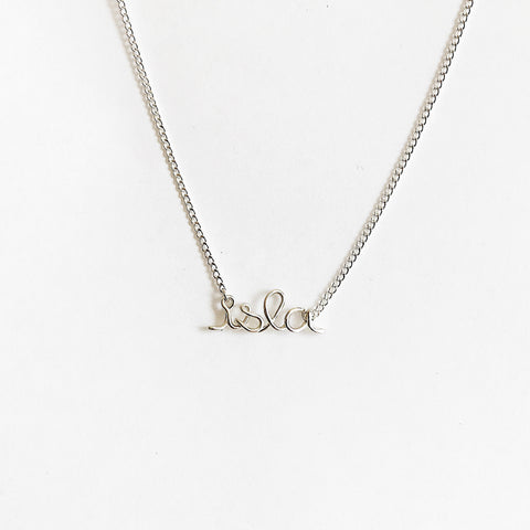 Personalised Isla name necklace wire in Argentium Silver handmade by Rachel and Joseph jewellery UK