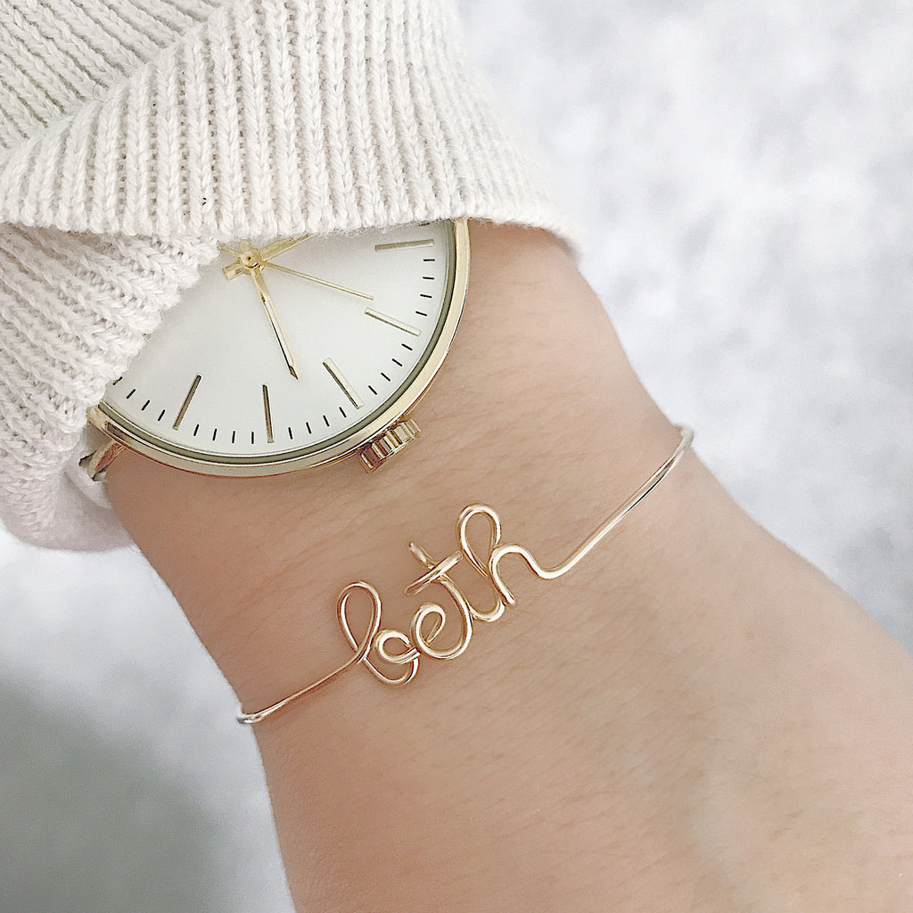 Personalised Beth name wire bangle bracelet in Yellow Gold handmade by Rachel and Joseph jewellery UK