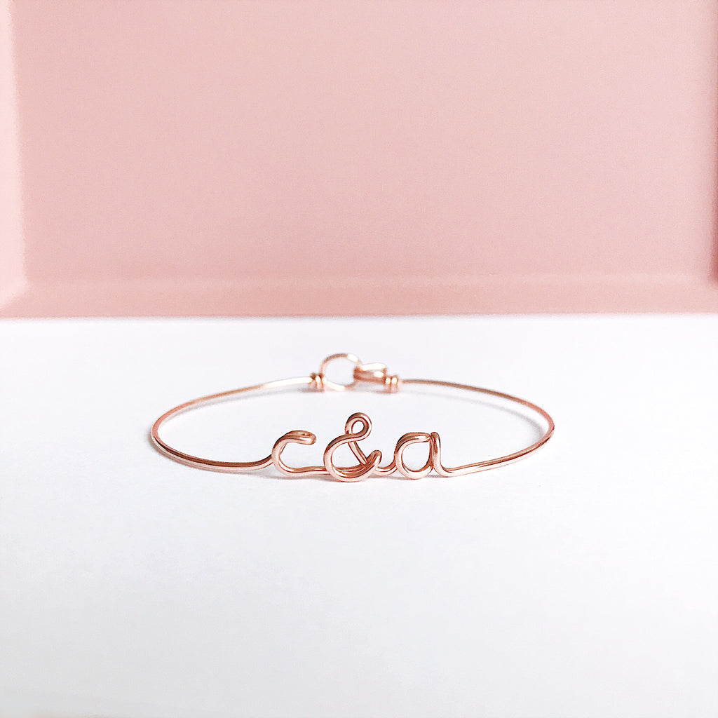 Personalised Initials with ampersand c&a wire bangle bracelet in Rose Gold handmade by Rachel and Joseph Jewellery UK