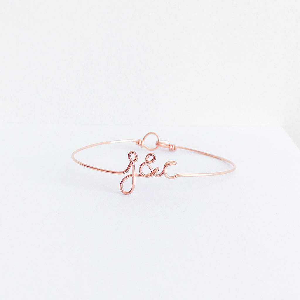 Personalised Initials with ampersand j&c wire bangle bracelet in Rose Gold handmade by Rachel and Joseph Jewellery UK