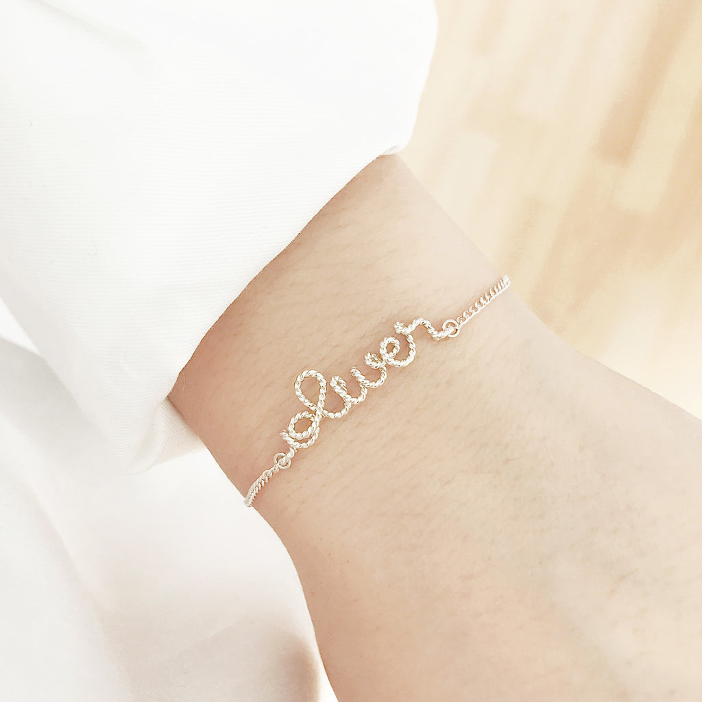 Personalised Oliver name chain bracelet in Argentium® Silver Twisted wire handmade by Rachel and Joseph jewellery UK