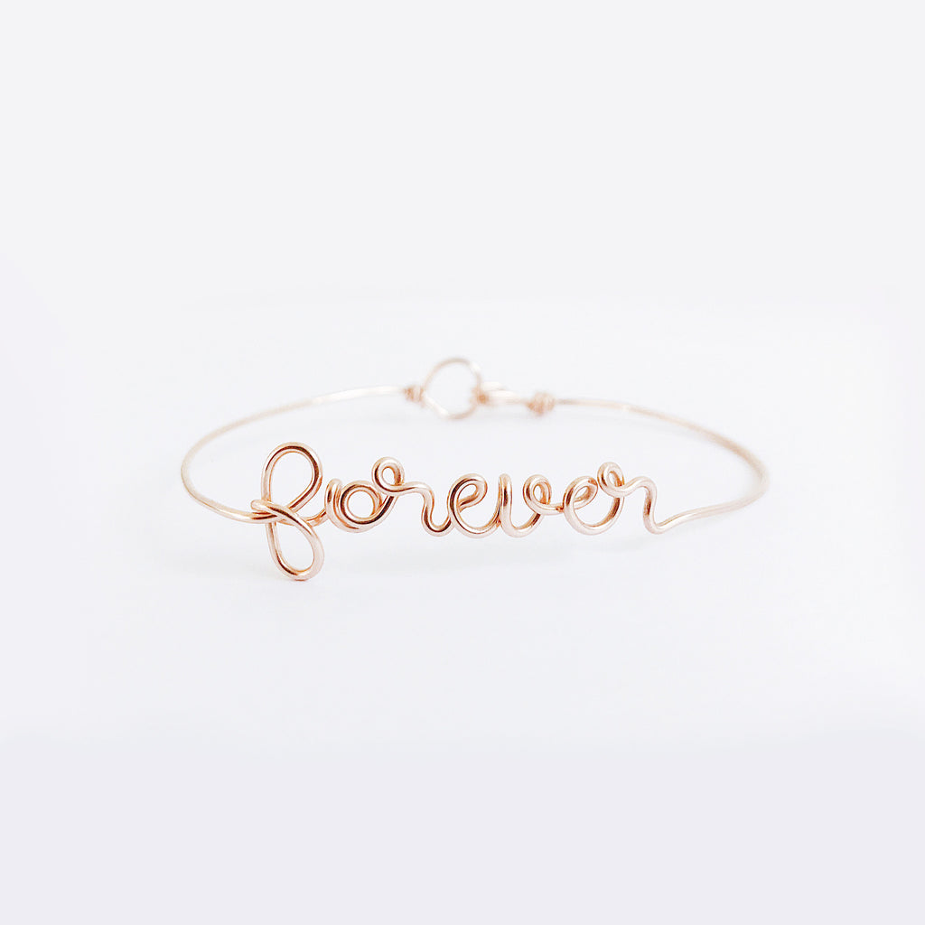 Personalised Forever name wire bangle bracelet in Rose Gold handmade by Rachel and Joseph jewellery UK