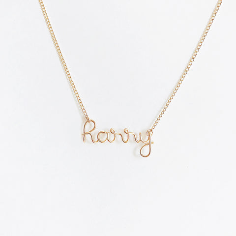 Personalised Harry name necklace in Yellow Gold filled wire handmade by Rachel and Joseph jewellery UK