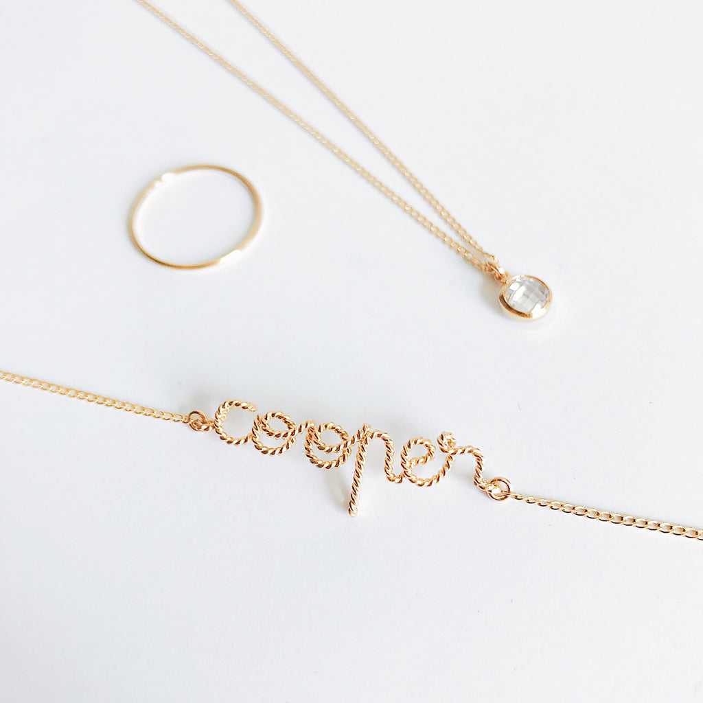 Personalised Cooper name Twisted wire chain bracelet in Yellow Gold handmade by Rachel and Joseph jewellery UK