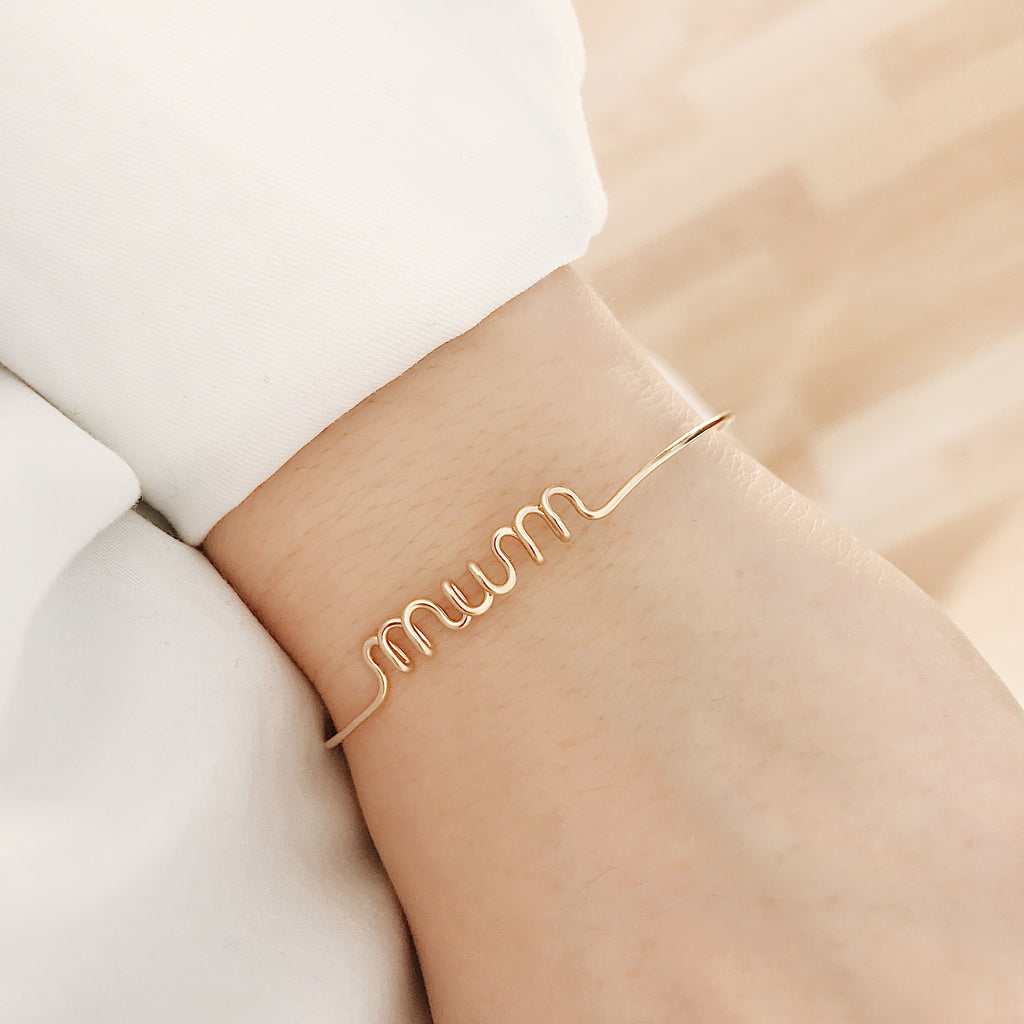 Personalised Mum name wire bangle bracelet in Yellow Gold handmade by Rachel and Joseph jewellery UK