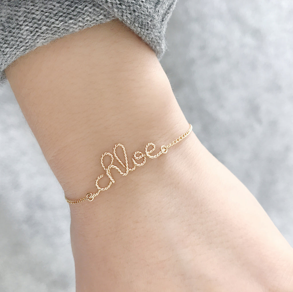 Personalised Chloe name Twisted wire chain bracelet in Yellow Gold handmade by Rachel and Joseph jewellery UK