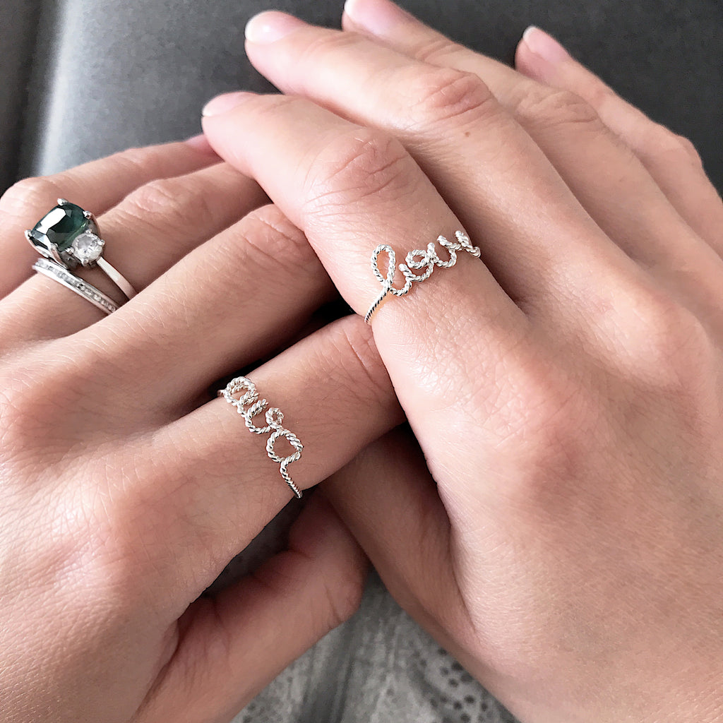 Personalised Duo Love name Ava twisted wire rings Argentium Silver handmade by Rachel and Joseph Jewellery in London, UK on hand