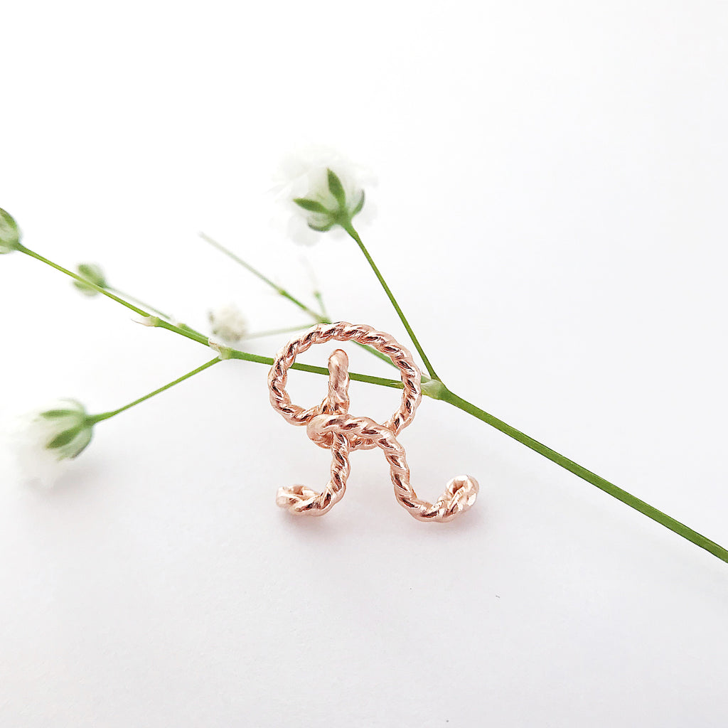 Personalised Initial R Uppercase Calligraphy handbag charm twisted wire in 14K rose Gold or Silver Argentium handmade by Rachel and Joseph Jewellery in London, UK