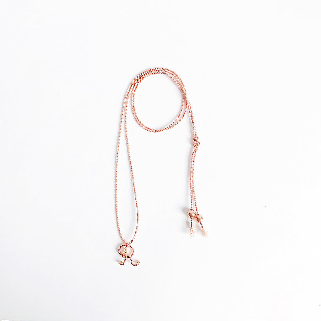 Personalised Initial R Uppercase Calligraphy wire natural light pink silk necklace in 14K rose Gold filled wire handmade by Rachel and Joseph Jewellery in London, UK wb