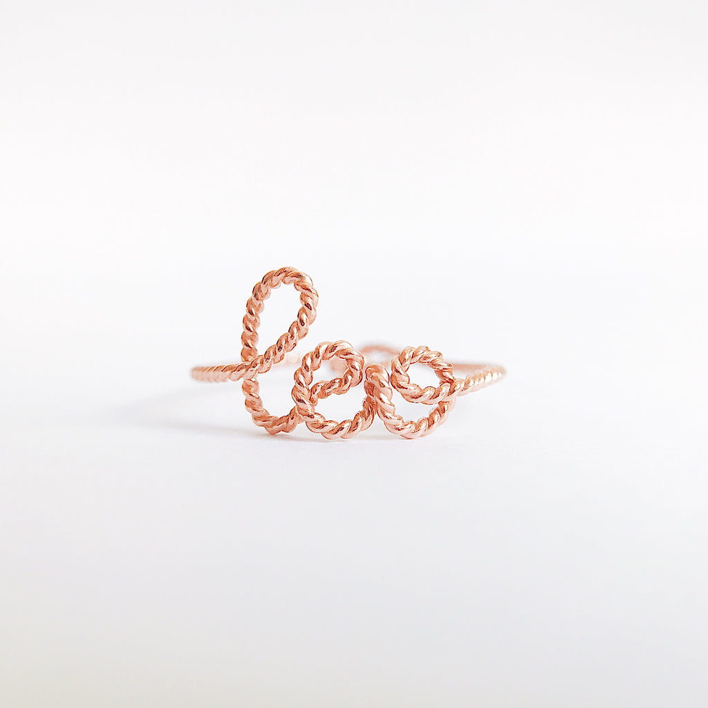 Personalised ring name Leo in Rose Gold twisted wire handmade by Rachel and Joseph jewellery UK