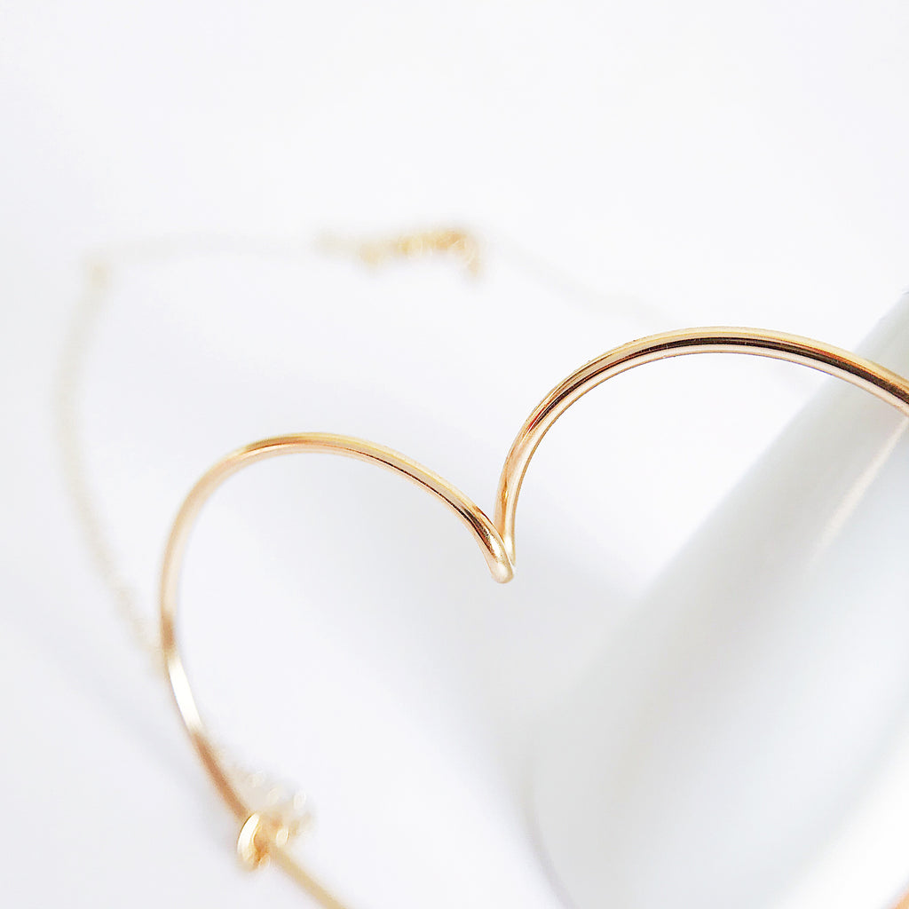 Close up of Big heart pendant chain necklace wire in 14K yellow or Rose Gold filled handmade by Rachel and Joseph Jewellery in London, UK