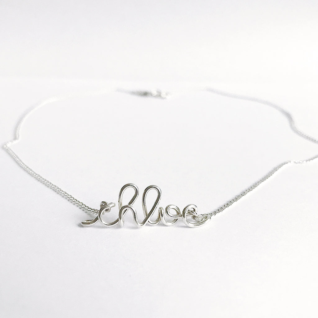 Personalised Chloe name necklace wire in Argentium Silver handmade by Rachel and Joseph jewellery UK