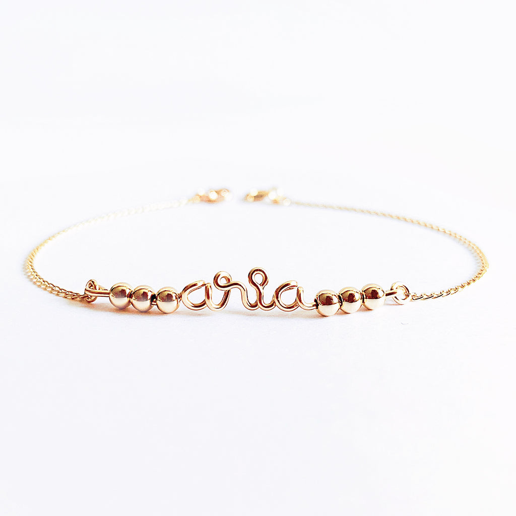 Personalised name Aria wire chain beads bar bracelet in 14K gold filled handmade by Rachel and Joseph Jewellery in London, UK WB Square
