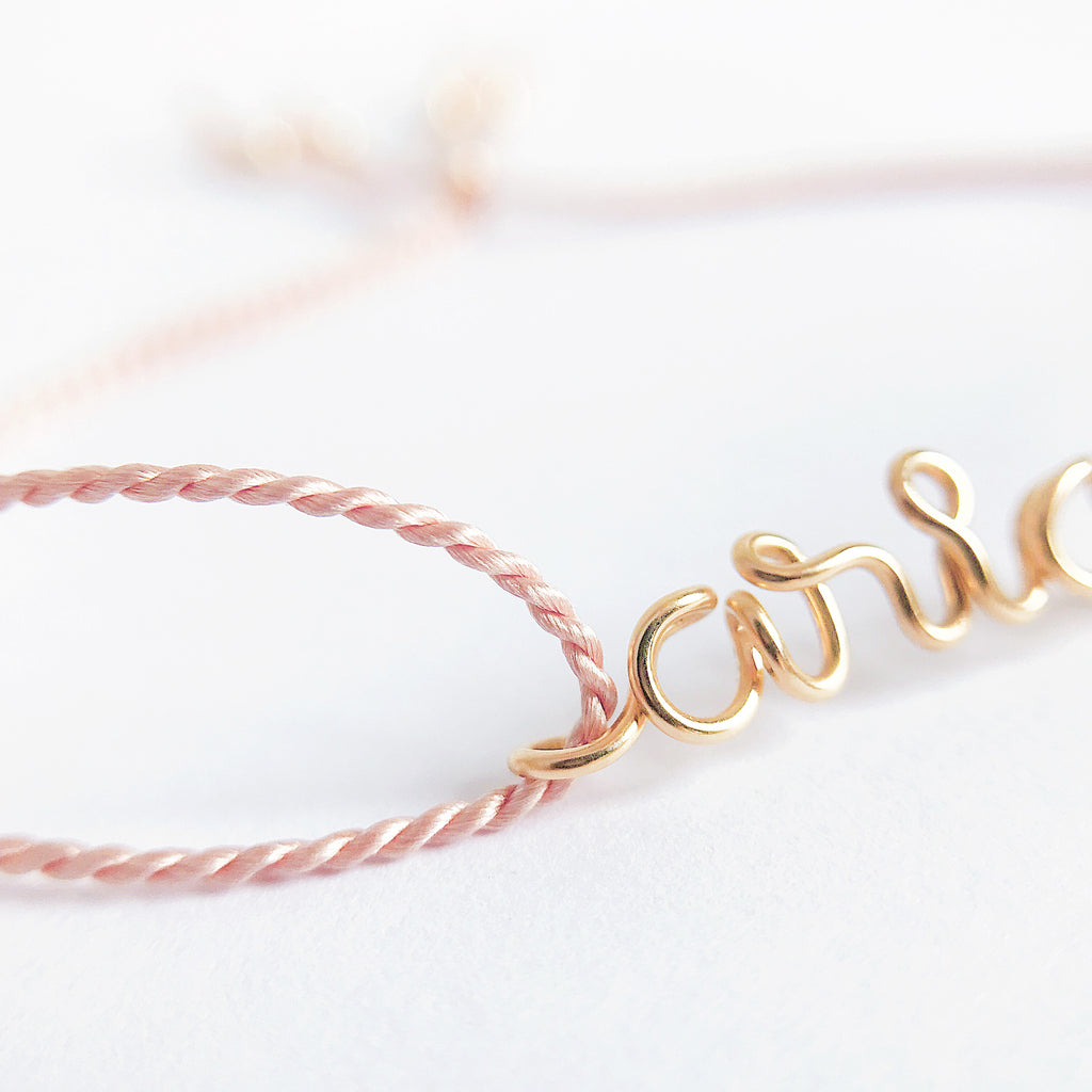 Personalised name Aria wire Light Pink natural Silk bracelet in 14K yellow gold filled handmade by Rachel and Joseph Jewellery in London, UK Details