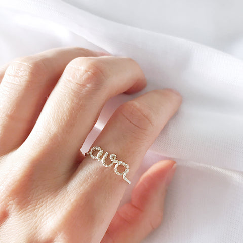 Personalised name Ava twisted wire ring Argentium Silver handmade by Rachel and Joseph Jewellery in London, UK