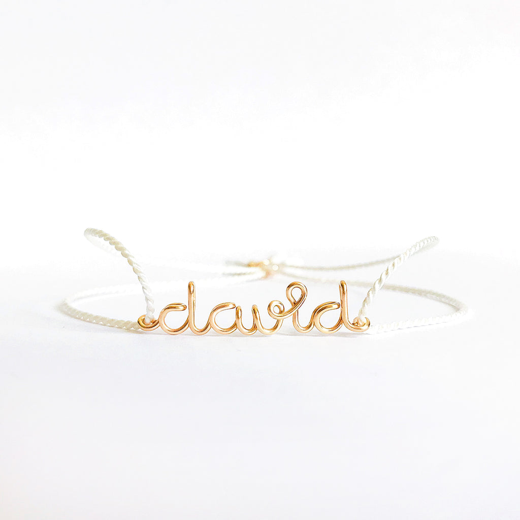 Personalised name David wire white natural Silk bracelet in 14K yellow gold filled handmade by Rachel and Joseph Jewellery in London, UK WB