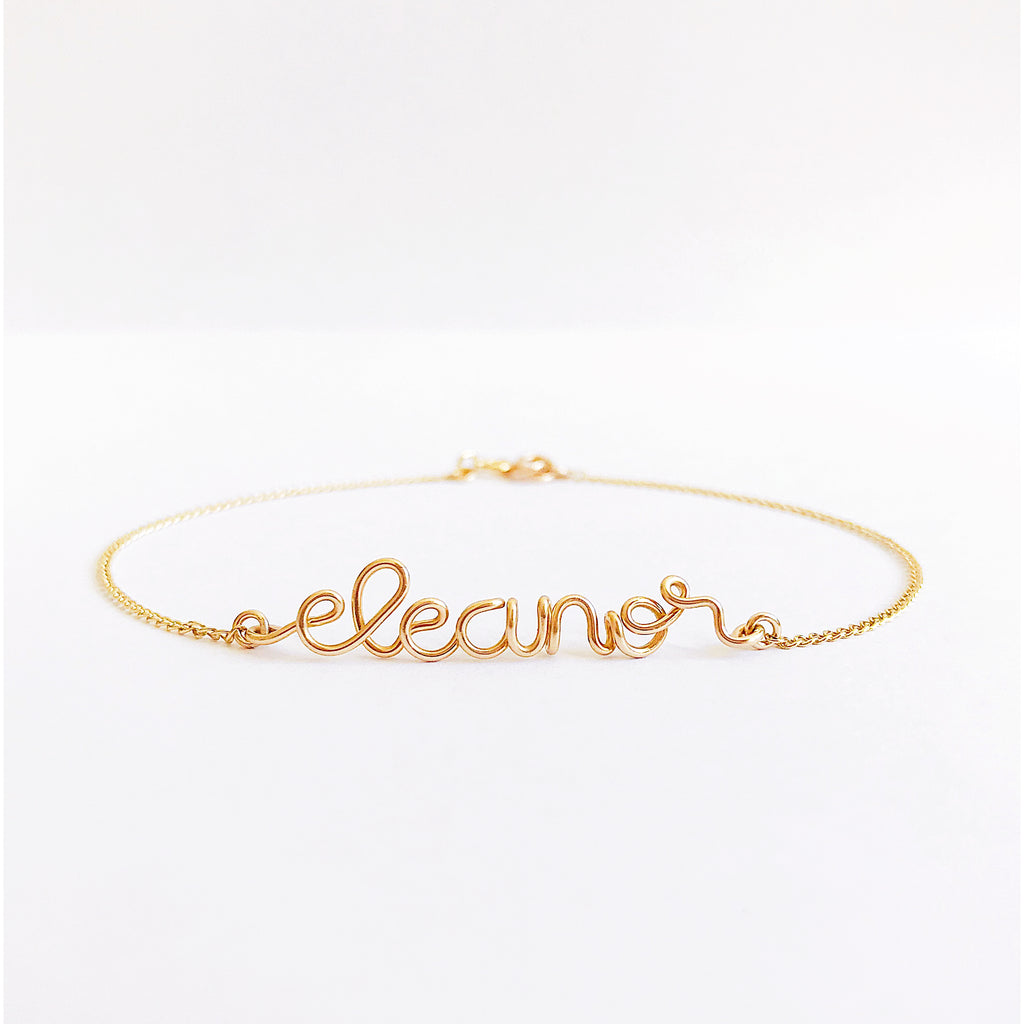 Personalised name Eleanore wire chain bracelet in 14K gold filled handmade by Rachel and Joseph Jewellery in London, UK wb square