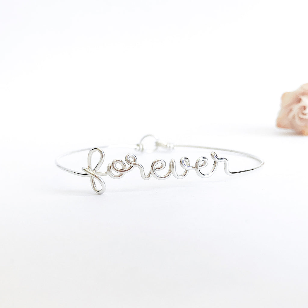 Personalised name Forever wire bangle bracelet Argentium Silver handmade by Rachel and Joseph Jewellery in London, UK