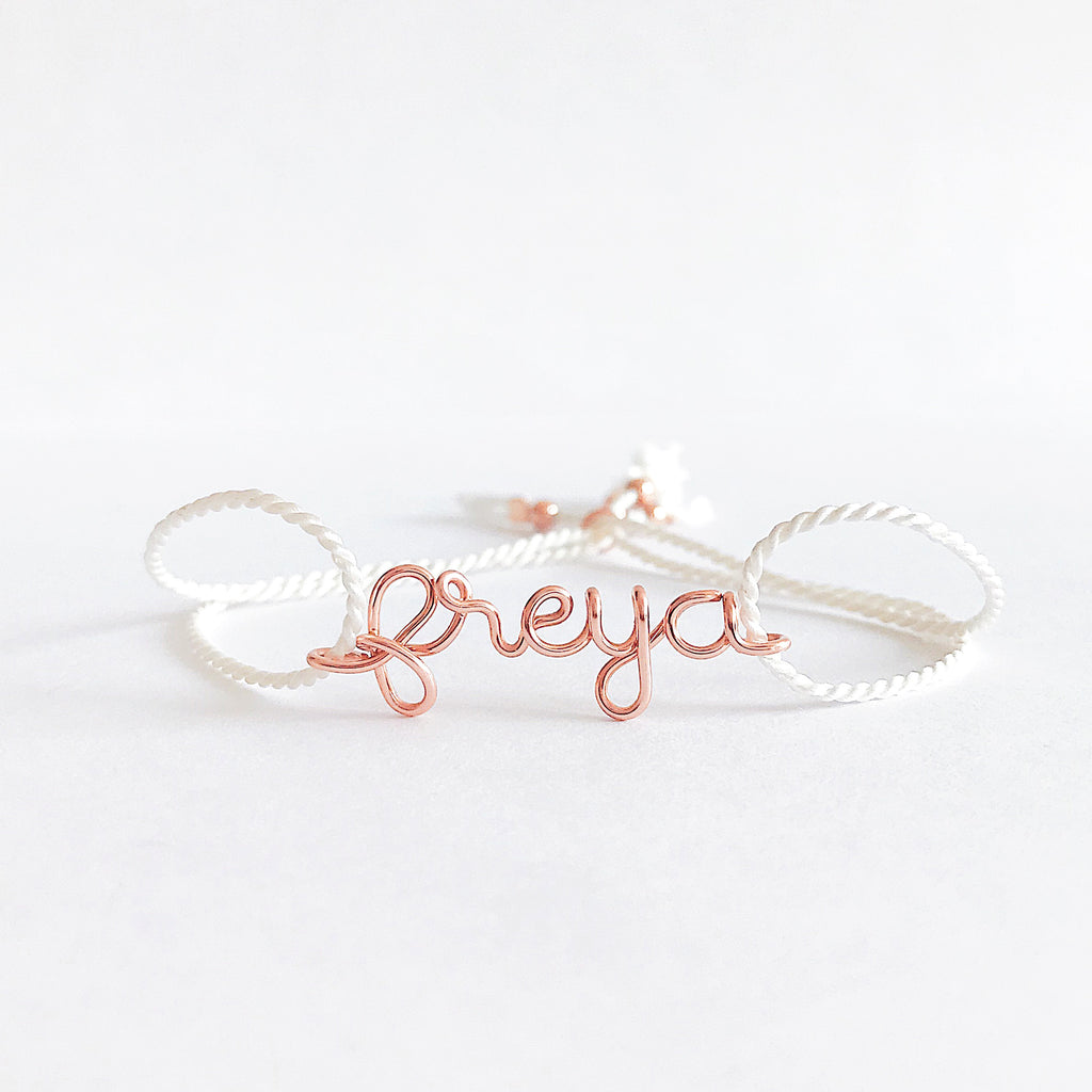 Personalised name Freya wire white natural Silk bracelet in 14K rose gold filled handmade by Rachel and Joseph Jewellery in London, UK WB