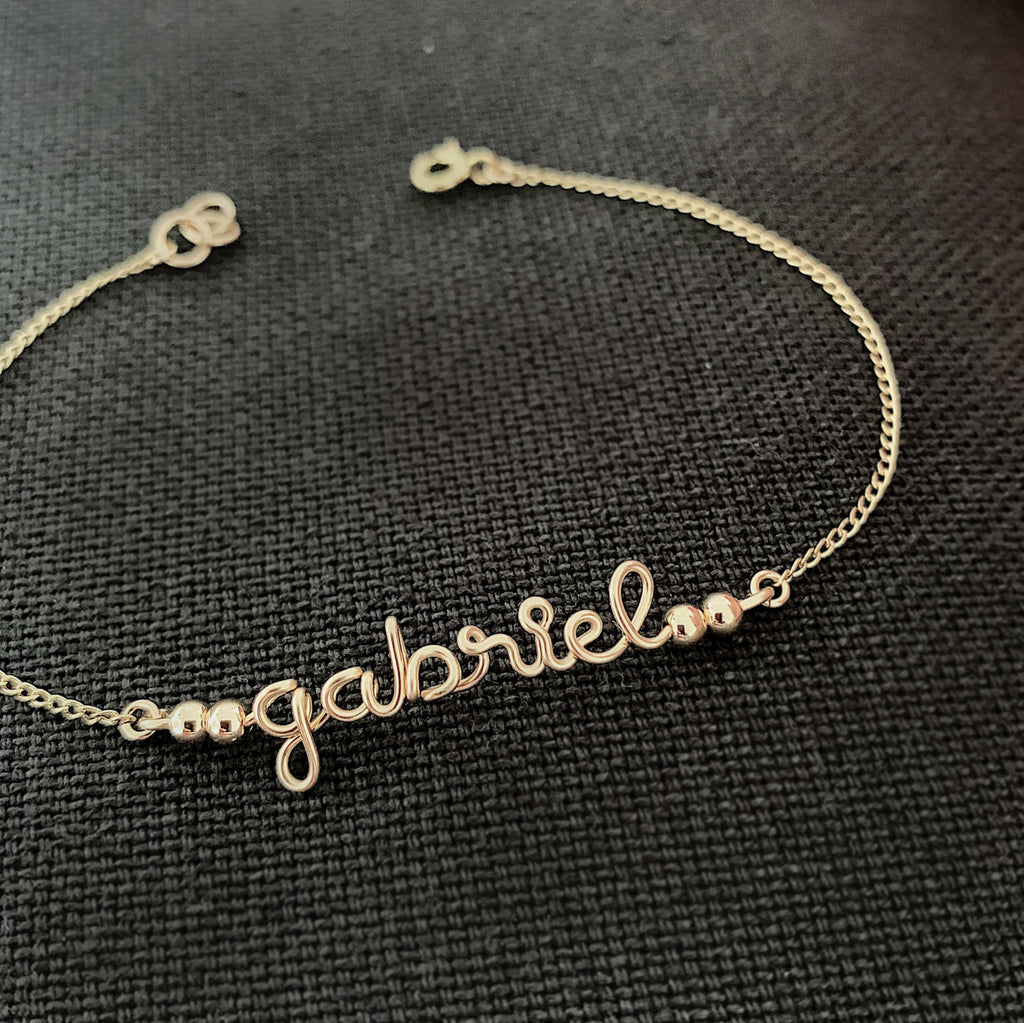Personalised name Gabriel wire chain beads bar bracelet in 14K gold filled handmade by Rachel and Joseph Jewellery in London, UK BB Square