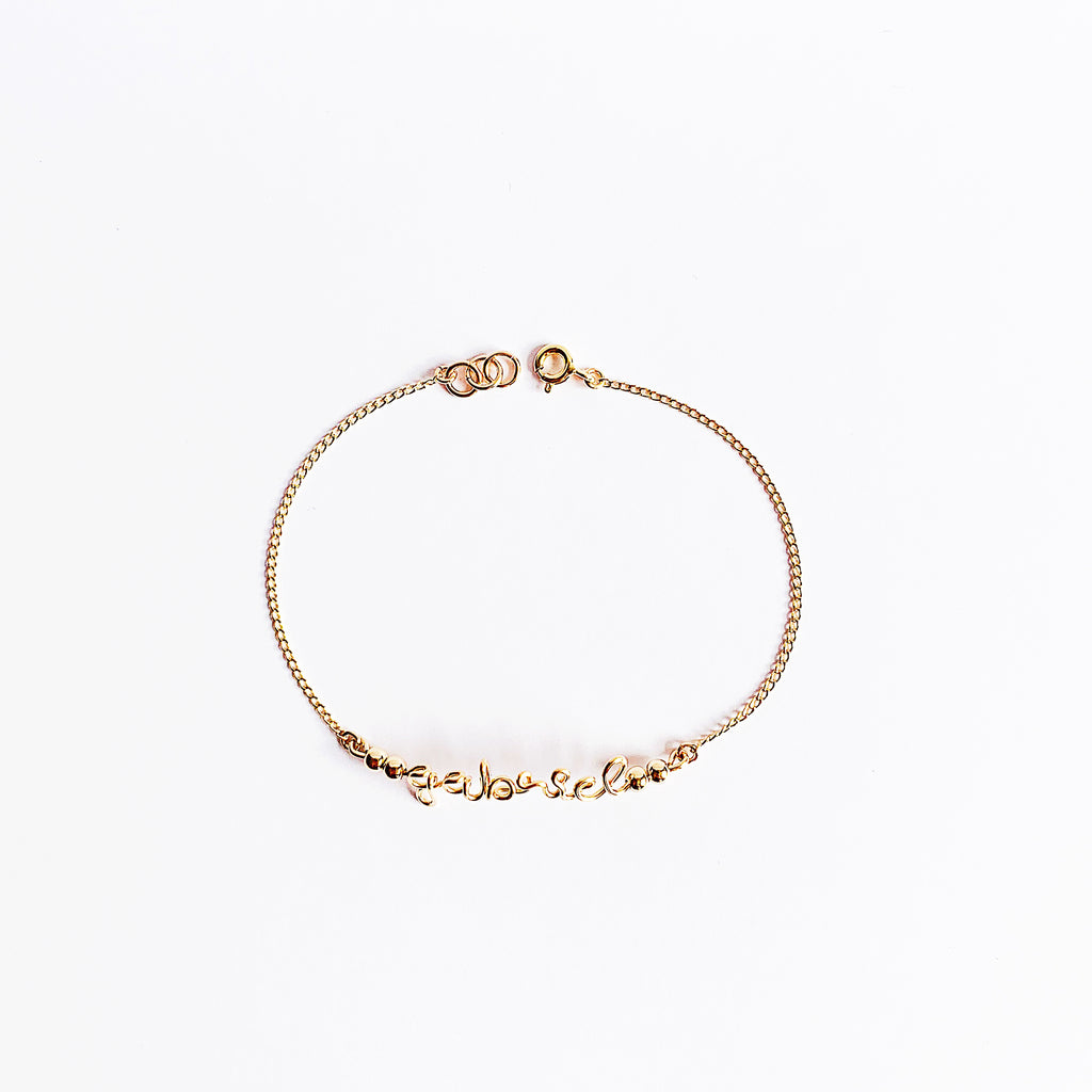 Personalised name Gabriel wire chain beads bar bracelet in 14K gold filled handmade by Rachel and Joseph Jewellery in London, UK WB View from above Square