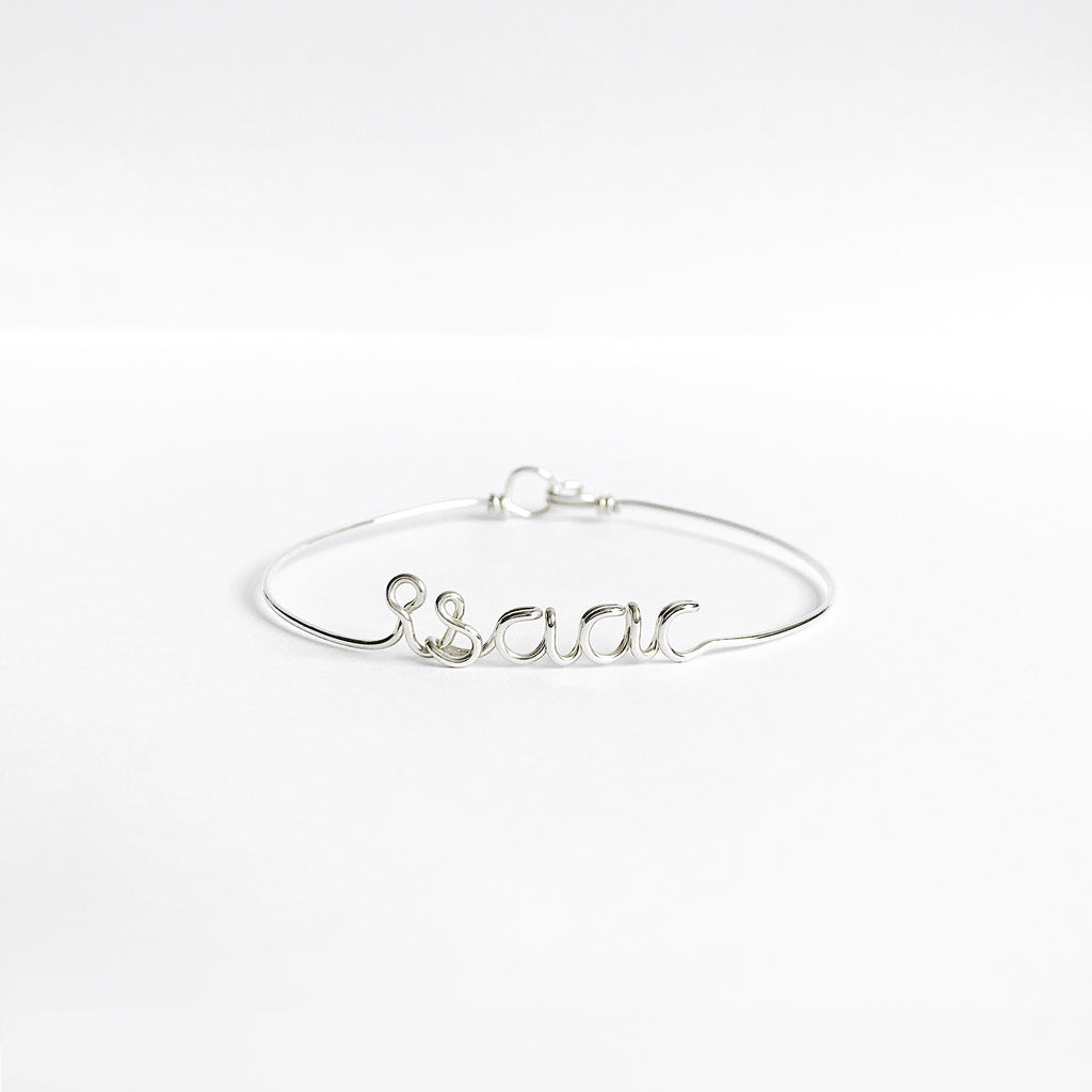 Personalised Isaac name wire bangle bracelet in Argentium Silver handmade by Rachel and Joseph jewellery UK