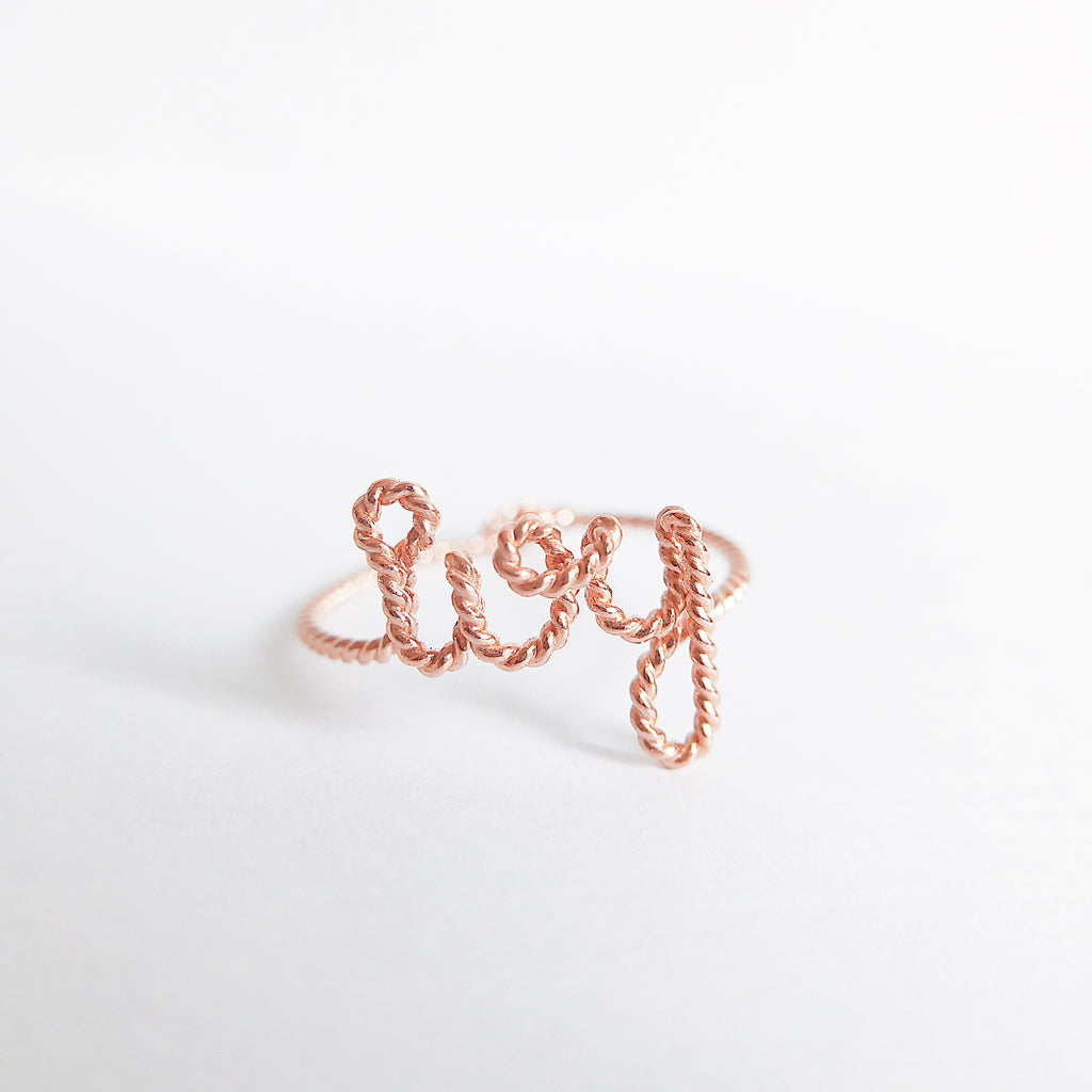 Personalised ring name Ivy in Rose Gold twisted wire handmade by Rachel and Joseph jewellery UK