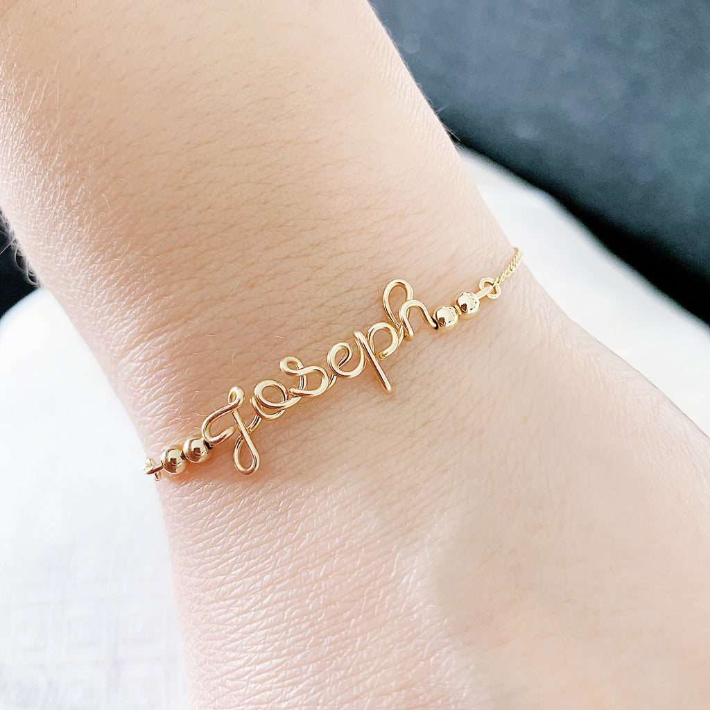 Personalised name Joseph wire chain beads bar bracelet in 14K gold filled handmade by Rachel and Joseph Jewellery in London, UK Hand
