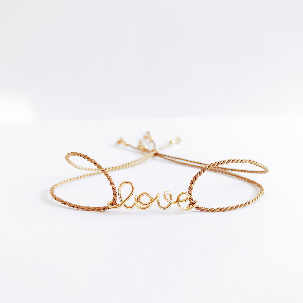 Personalised name Love wire beige natural Silk bracelet in 14K yellow gold filled handmade by Rachel and Joseph Jewellery in London, UK WB