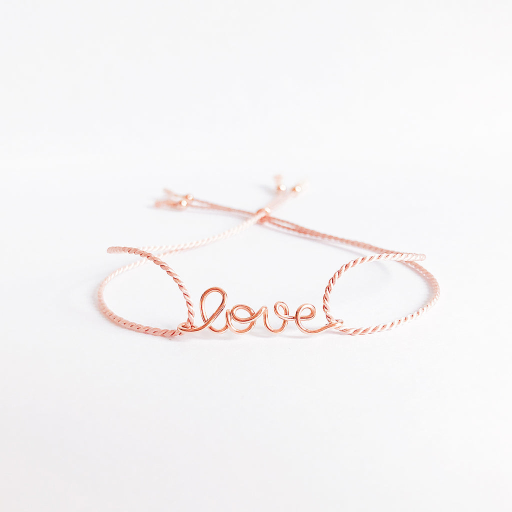 Personalised name Love wire Light Pink natural Silk bracelet in 14K rose gold filled handmade by Rachel and Joseph Jewellery in London, UK WB