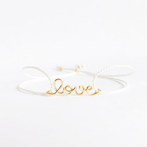 Personalised name Love wire White natural Silk bracelet in 14K yellow gold filled handmade by Rachel and Joseph Jewellery in London, UK WB