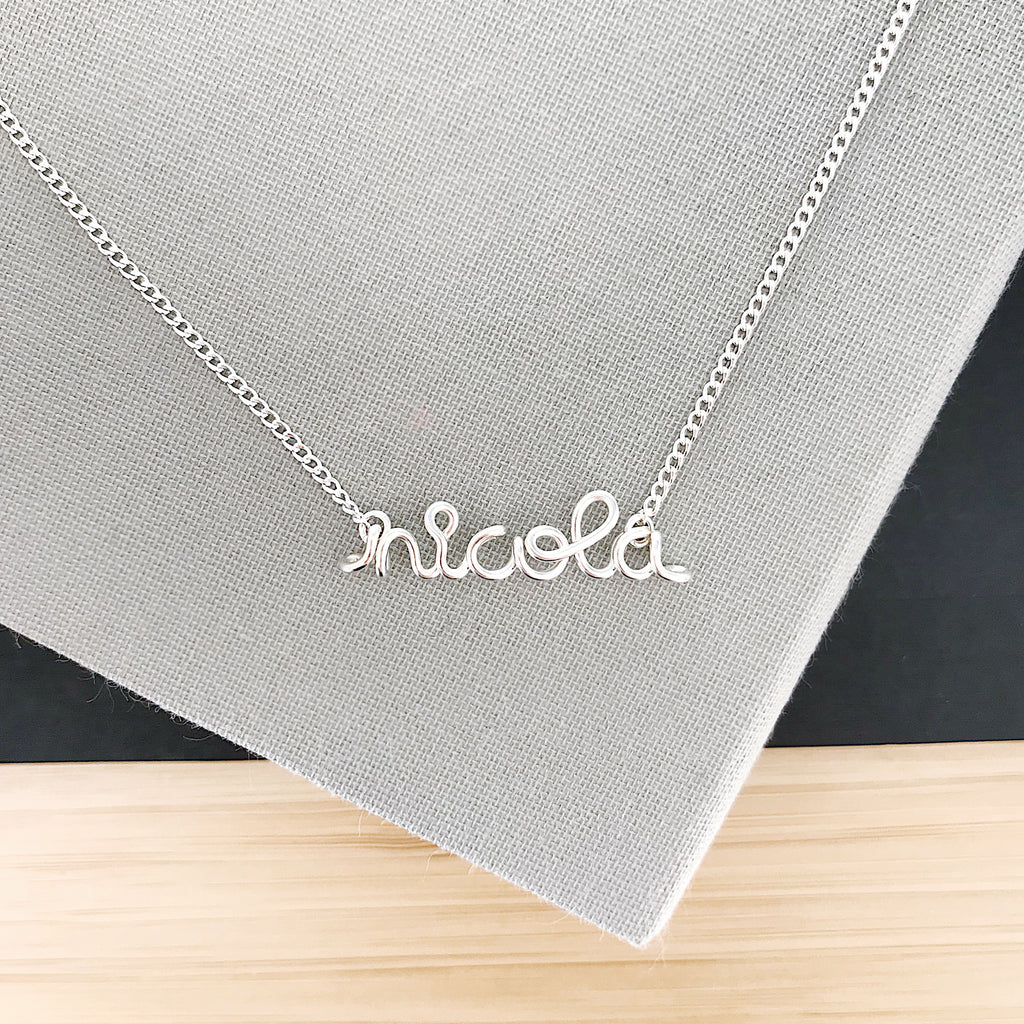 Personalised name Nicola wire pendant necklace in Argentium® Silver handmade by Rachel and Joseph Jewellery in London, UK
