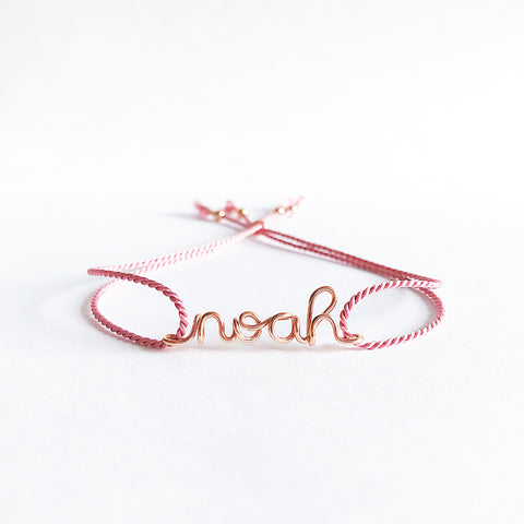 Personalised name Noah wire Dark pink natural Silk bracelet in 14K rose gold filled handmade by Rachel and Joseph Jewellery in London, UK WB