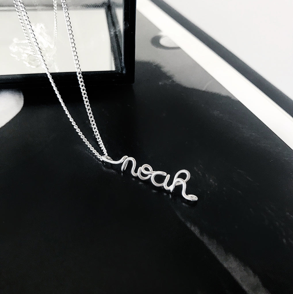 Personalised name Noah wire pendant necklace in Argentium Silver handmade by Rachel and Joseph Jewellery in London, UK