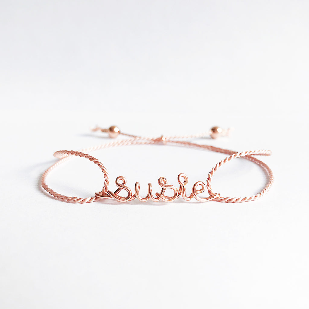 Personalised name susie wire light pink natural Silk bracelet in 14K rose gold filled handmade by Rachel and Joseph Jewellery in London, UK WB