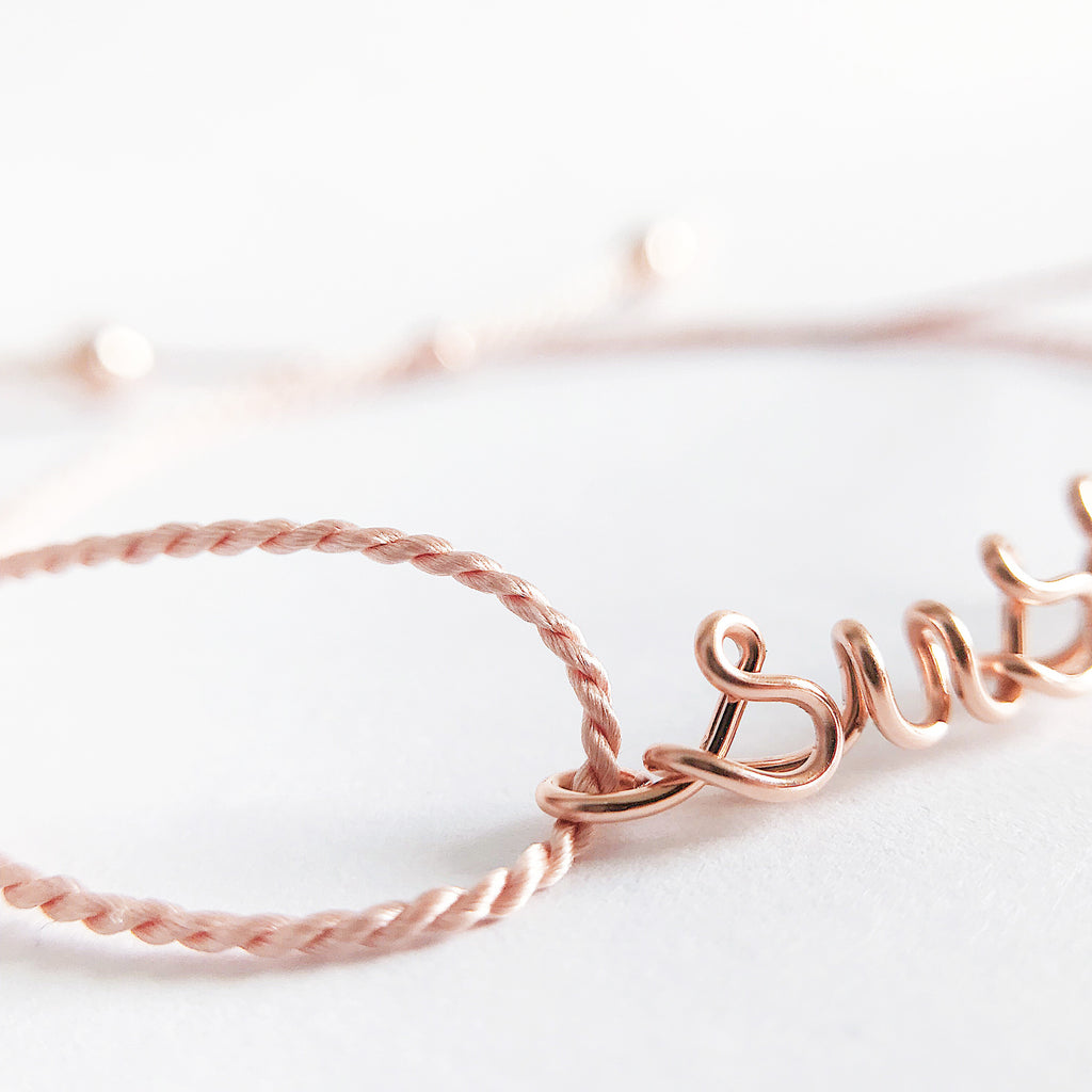 Personalised name susie wire light pink natural Silk bracelet in 14K rose gold filled handmade by Rachel and Joseph Jewellery in London, UK Details