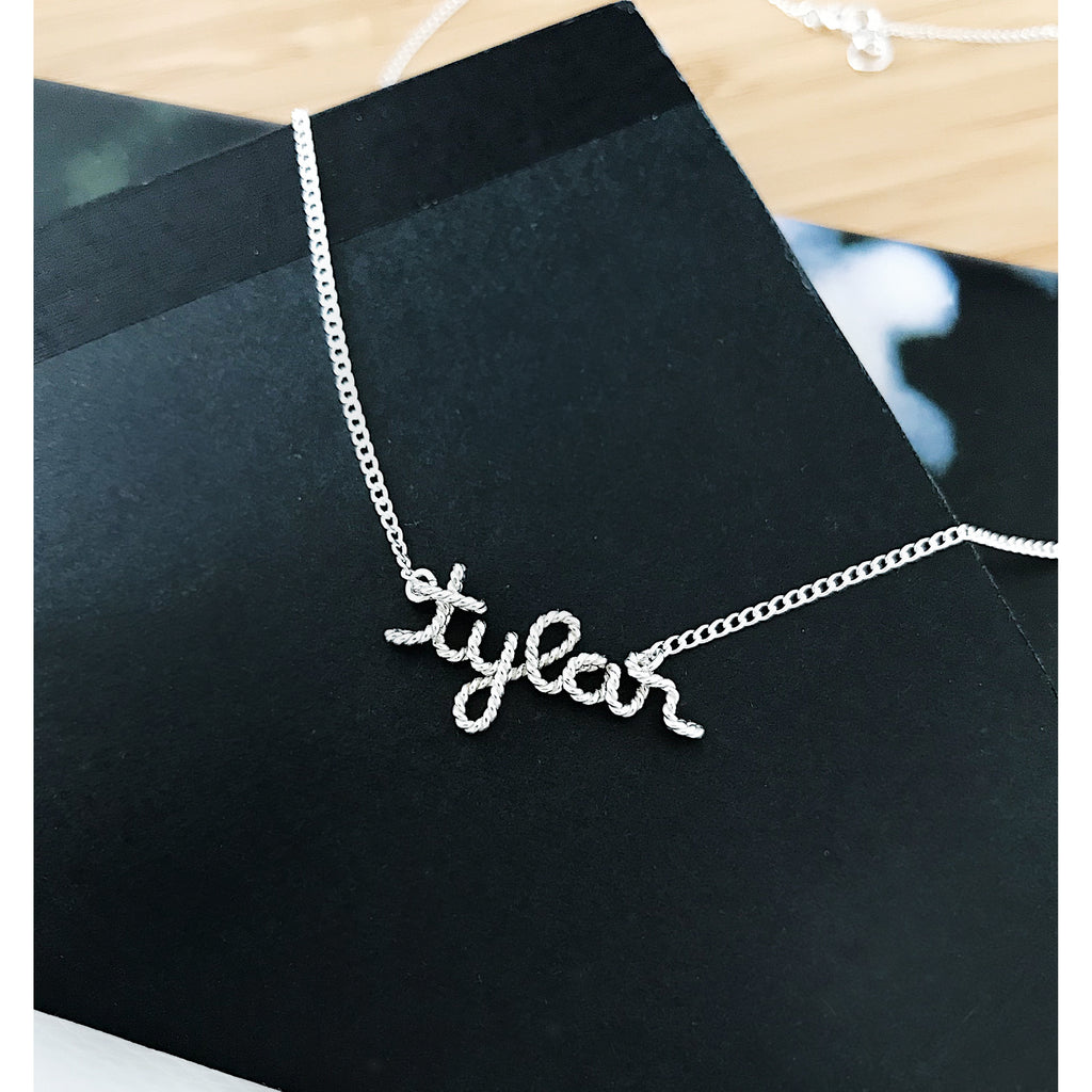 Personalised name Tylar wire pendant necklace in Argentium® Silver handmade by Rachel and Joseph Jewellery in London, UK