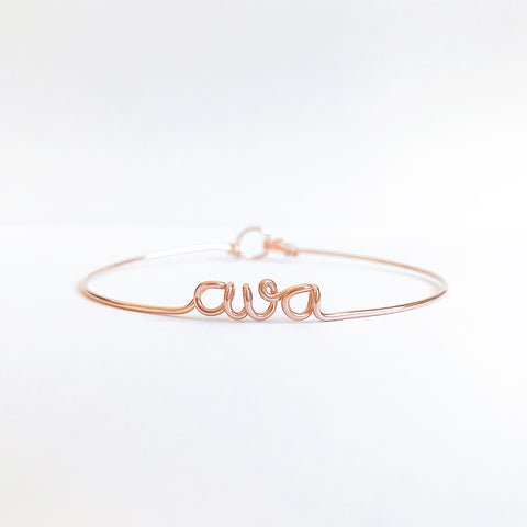 Personalised ava name wire bangle bracelet in Rose Gold handmade by Rachel and Joseph jewellery UK