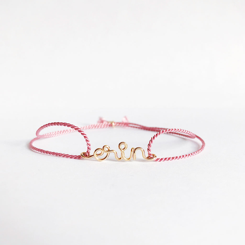 Personalised name Erin wire Dark Pink natural Silk bracelet in 14K yellow gold filled handmade by Rachel and Joseph Jewellery in London, UK WB