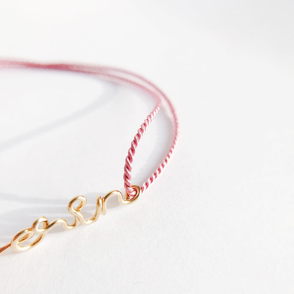Personalised name Erin wire Dark Pink natural Silk bracelet in 14K yellow gold filled handmade by Rachel and Joseph Jewellery in London, UK Details