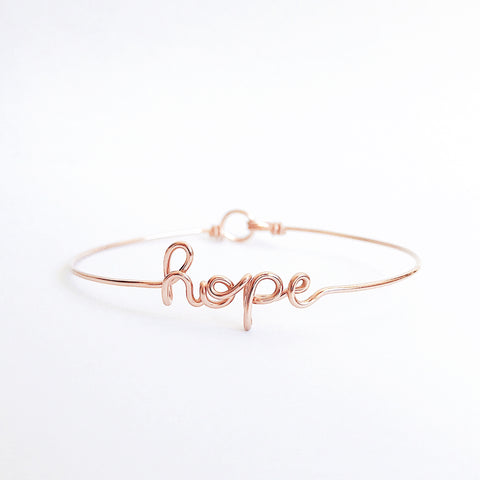 Personalised Hope name wire bangle bracelet in Rose Gold handmade by Rachel and Joseph jewellery UK