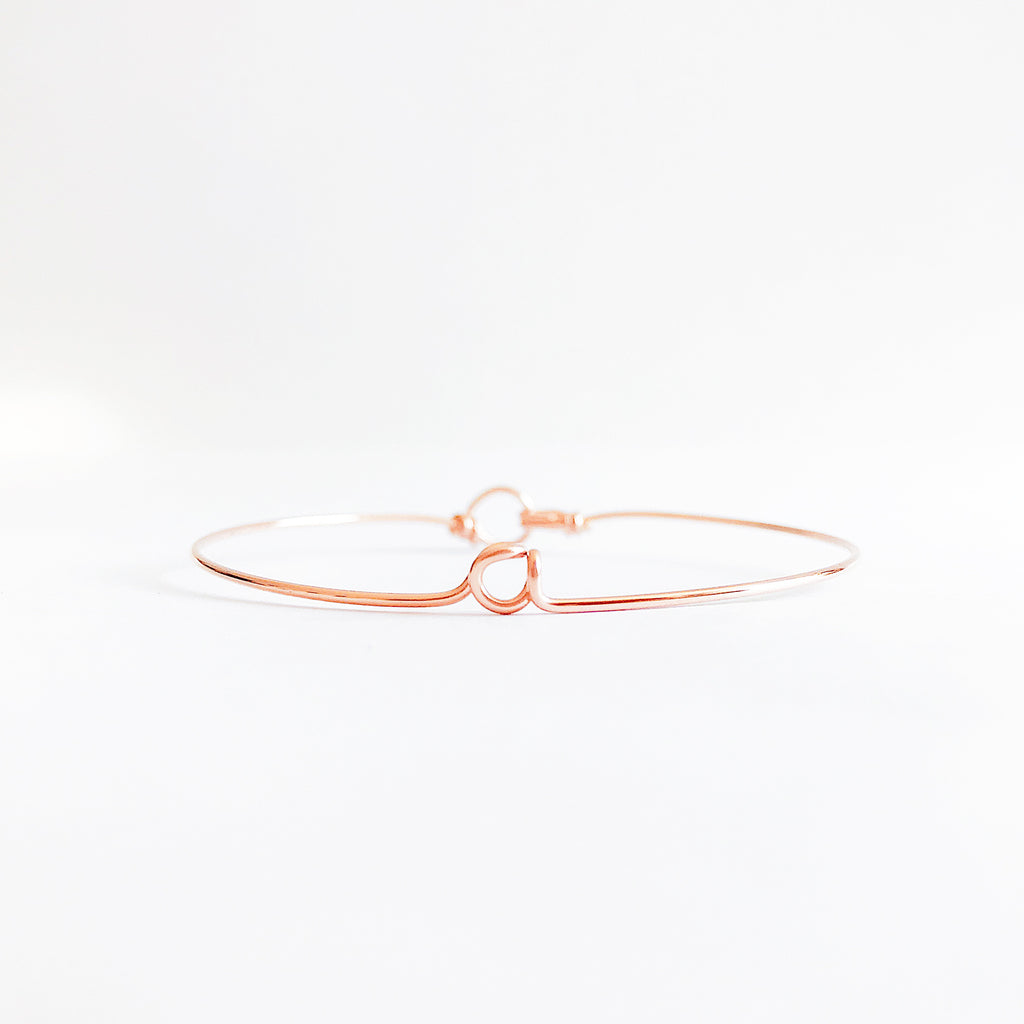 Personalised name initial a wire bangle bracelet in 14K Rose gold filled handmade by Rachel and Joseph Jewellery in London, UK wb
