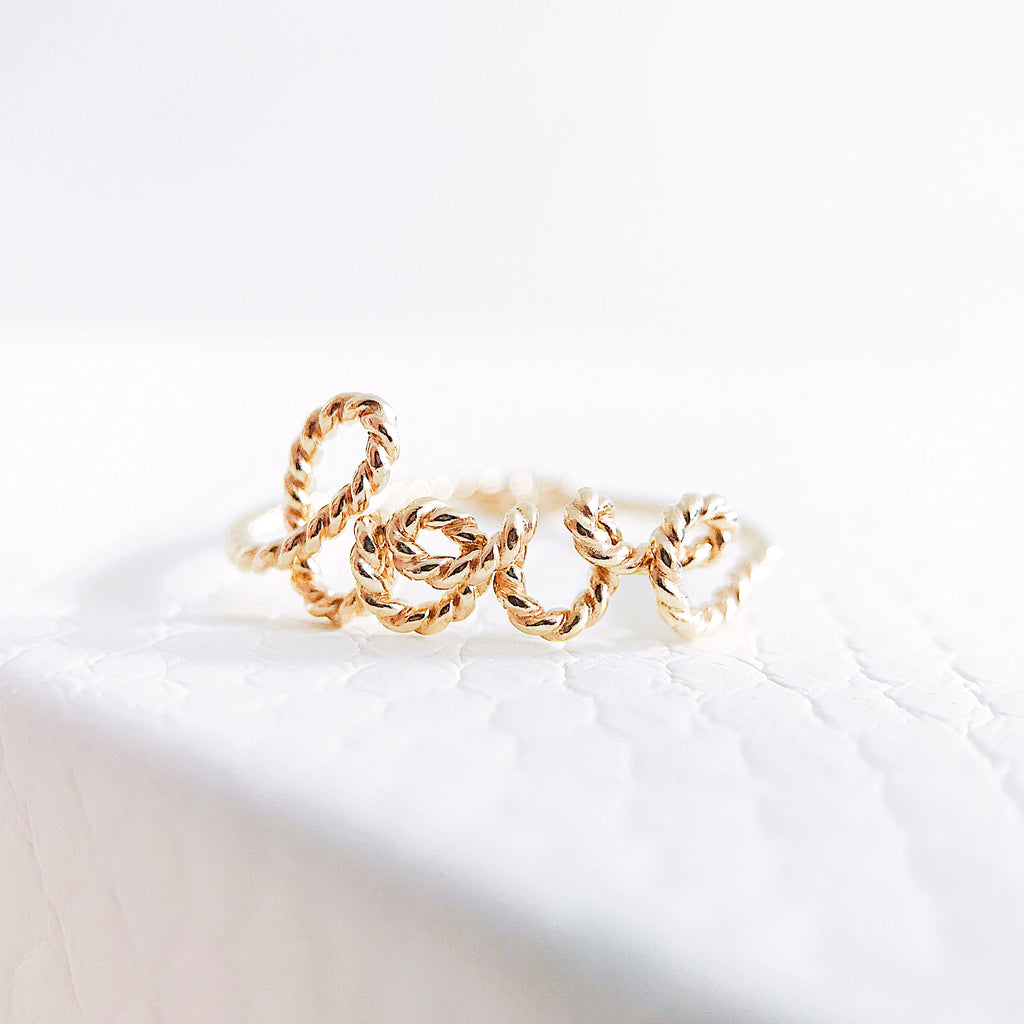 Personalised name love twisted wire ring 14K yellow gold filled handmade by Rachel and Joseph Jewellery in London, UK wb