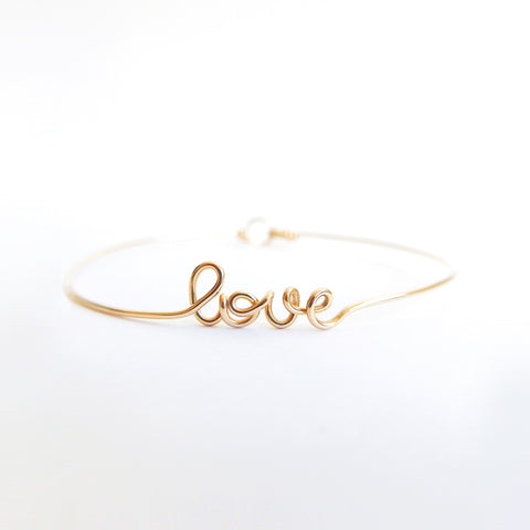 Personalised name love wire bangle bracelet 14K yellow gold filled handmade by Rachel and Joseph Jewellery in London, UK square