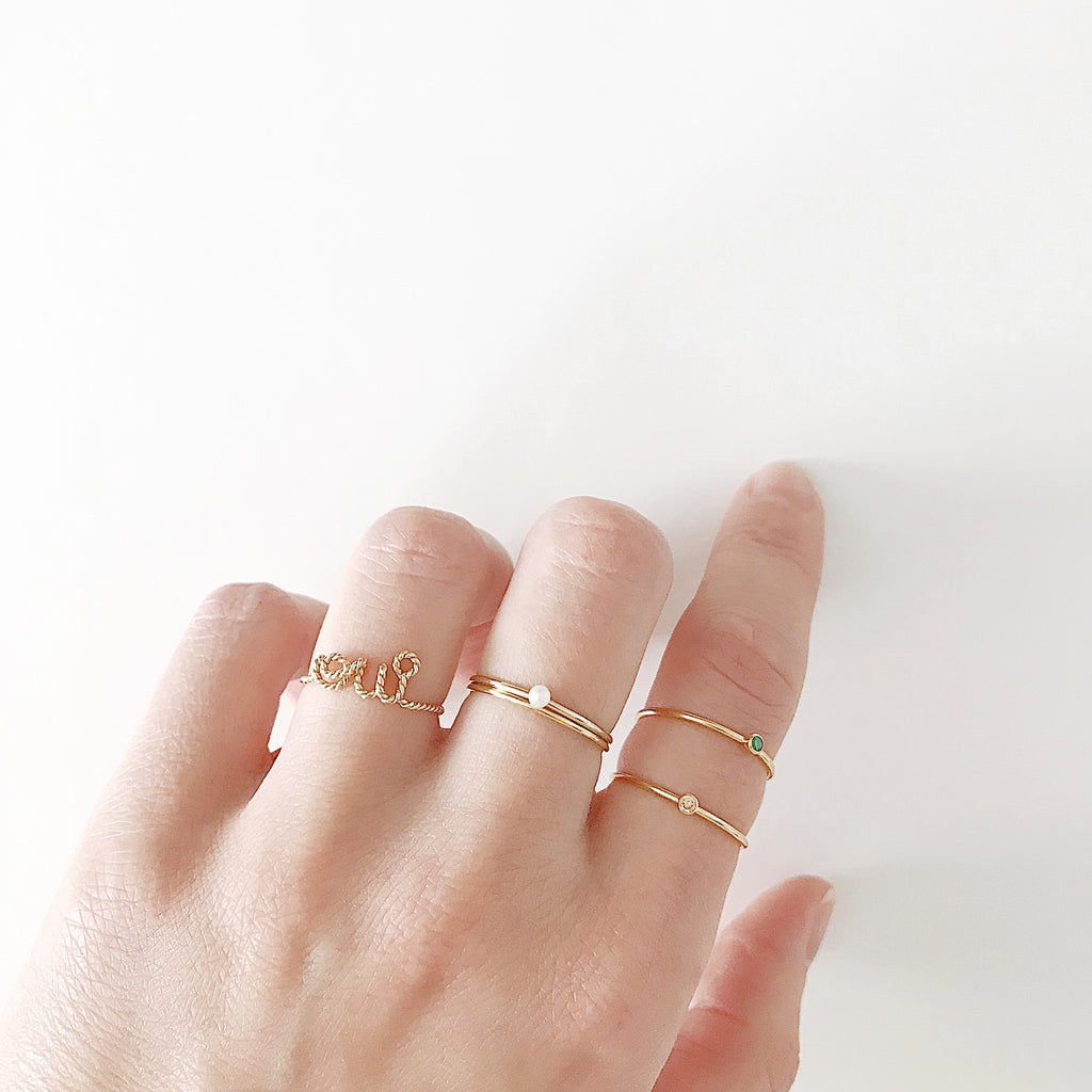 Personalised name oui twisted wire ring 14K yellow gold filled handmade by Rachel and Joseph Jewellery in London, UK