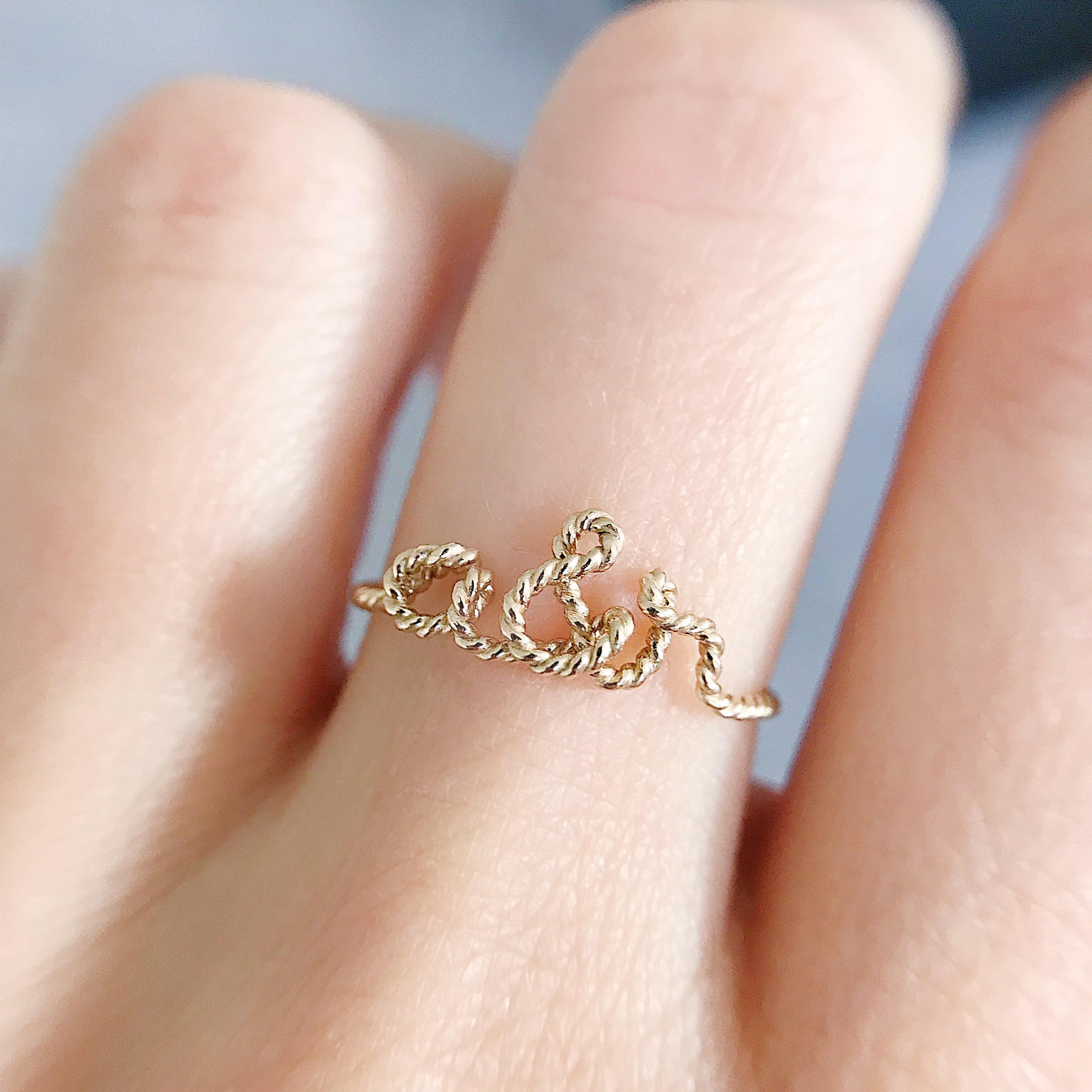 Personalised name 'you and me' a&r Ampersand twisted wire ring 14K yellow gold filled handmade by Rachel and Joseph Jewellery in London, UK hand Square