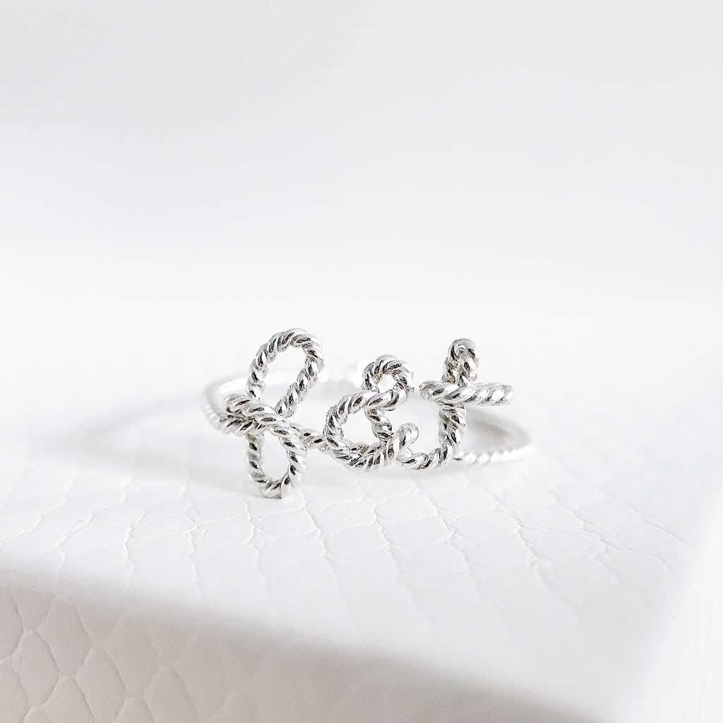 Personalised name 'you and me' f&t Ampersand twisted wire ring Argentium Silver handmade by Rachel and Joseph Jewellery in London, UK WB
