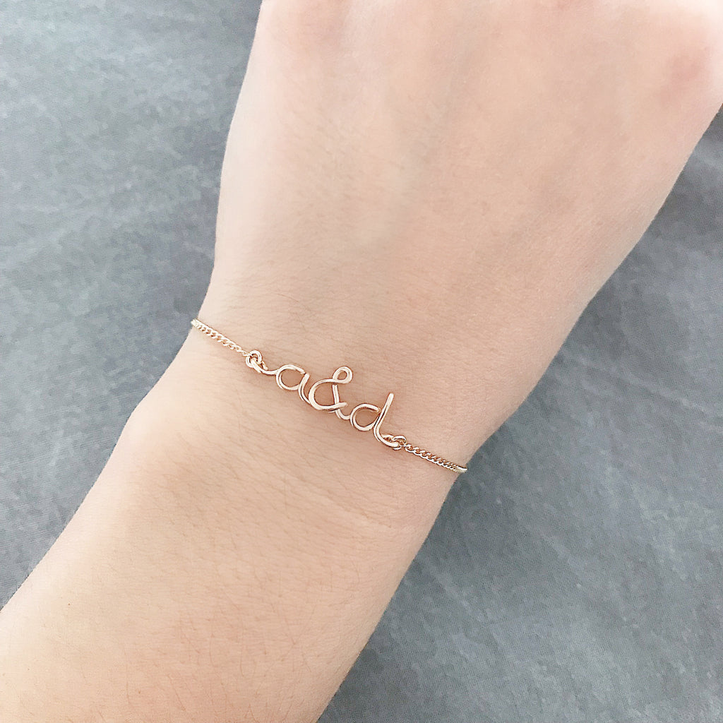 Personalised name you and me initials round wire chain bracelet in 14K gold filled handmade by Rachel and Joseph Jewellery in London, UK Hand