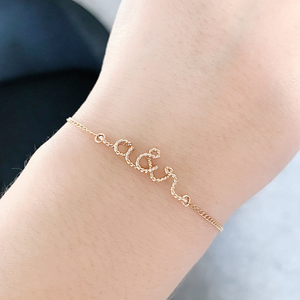 Personalised name you and me initials twisted wire chain bracelet in 14K gold filled handmade by Rachel and Joseph Jewellery in London, UK Hand
