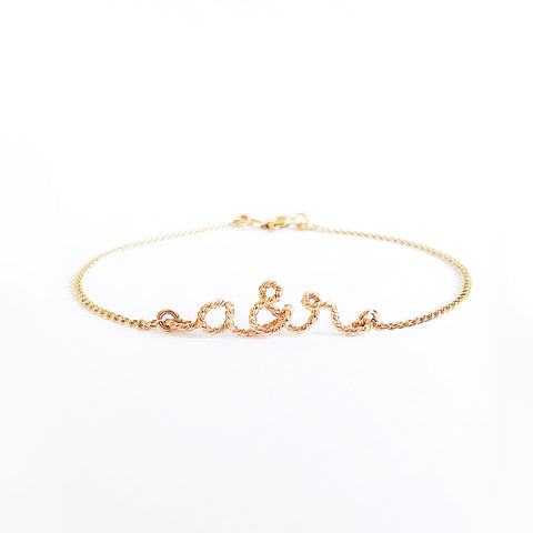 Personalised name you and me initials twisted wire chain bracelet in 14K gold filled handmade by Rachel and Joseph Jewellery in London, UK wb